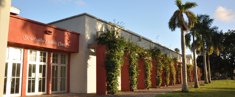 Side of the Church with entrance and vines going from ground to ledge