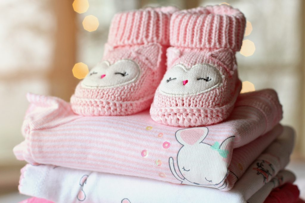 Little pink clothing items for a baby